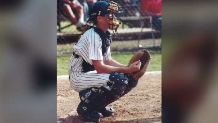 baseball catcher squatting, ready